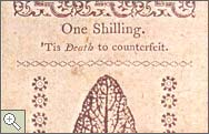 A one shilling note